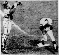 Johnnie LeMaster scored the tying run in the 9th inning as Bob Boone catches the high throw.