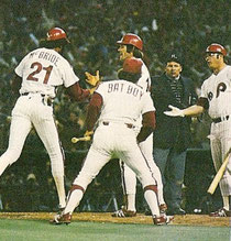 Bake McBride arrives home to a big welcome after his home run.