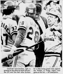The Cards' Leon Durham is congragulated at home plate after blasing a grand slam in the 5th.