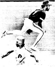 Ozzie Smith finishes a double play over Garry Maddox.