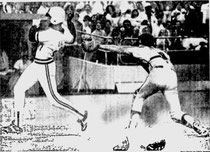 Lee Lacy eludes Bob Boone's tag to score in the 5th.