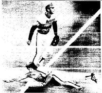Pete Rose slides safely into third during the first inning.