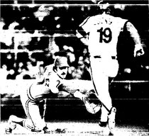 Greg Luzinski takes first as Keith Hernandez reaches for a wide throw.