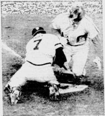Pete Rose is tagged out at home by Milt May in the 2nd inning.
