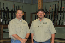 Owners Jeff Leonard and Bruce Schmitter in the firearms department at J & B Outdoors.