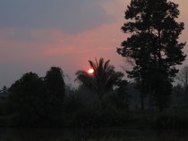 Sunset over a village in eastern Thailand