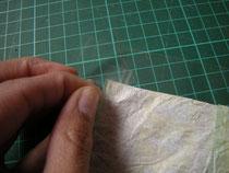 Laminierfolie am Quilt festkleben