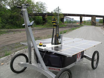 The modified Zoe rover, with the upper portion of the drill mechanism jutting above the solar array (Credit: Carnegie Mellon Robotics Institute)