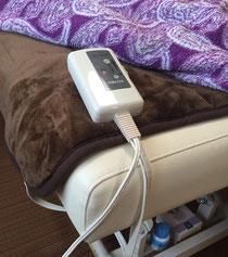 ベッドに電気毛布を敷きます