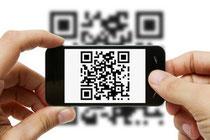 """Detalle de captación de un """"Código QR"""" con un teléfono móvil."""