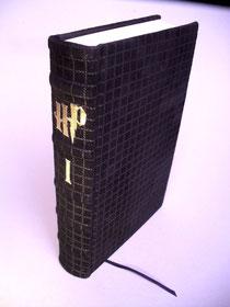 Harry Potter und der Stein der Weisen in Leder gebunden