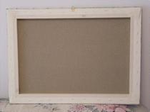 Il retro della pittofotografia montata sul telaio di legno