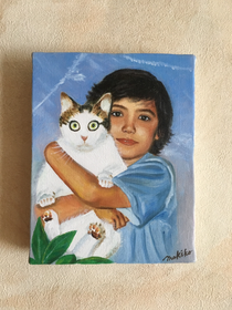 A boy in Madrid with his cat