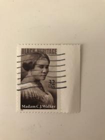 Francobollo commemorativo di Madam CJ Walker (al secolo Sarah Breedlove), la prima donna americana a diventare milionaria commercializzando prodotti per capelli per donne afroamericane