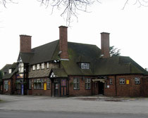 Rebuilt in 1938 after a fire the Coach & Horses stands overlooking The Green..