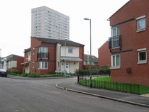 New housing in James Samuel Place, off Conybere Street, 1960s flats in the background.