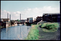 The view towards the Bristol Road looking away from the City Centre photographed by Phyllis Nicklin. On the right bank of the canal can be seen the bridge over the entrance to the Dudley No.2 Canal. See Acknowledgements Keith Berry.