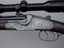 Single Barrel Rifle engraved with English Fine Scroll and game scenes
