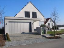 Einfamilienhaus mit Flachdachgarage