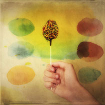 vintage style photo, once upon a time a colorful candy, retro style hand and candy photograph