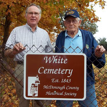 Gerald White (left) and his uncle Wayne White accept a new sign for the White Cemetery donated by the McDonough County Historical Society.