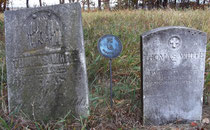 The family headstone (left) and government marker (right) for Thomas White, veteran of the Revolutionary War with the Macomb DAR medallion between them.