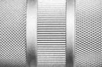 Cross-hatched, herringbone and straight knurling with the same knurling rollers
