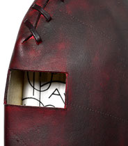 gut knowledge, detail (2014) cuir bouilli formed leather, leather dye, thongs, hand writing on paper, 11 x 5 x 3.75 inches