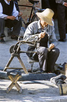 Old man working in the streets of Old Tingri, Tibet 1993