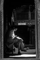 Woman reading a book, Patan, Nepal 1993