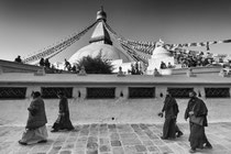 Tibetan people  walking around the great stupa of Boudhanath, Nepal 2013