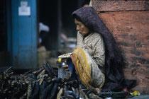 Old woman selling dried fish, Kathmandu, Nepal 1993