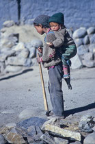 Young girl with a little kid on her back, Sakya, Tibet 1993