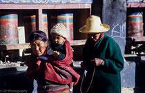 People rolling the praying wheels in Drepung Monastery, Tibet 1993
