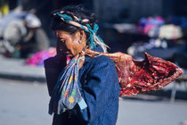 Woman with meat in the streets of Shigatse, Tibet 1993