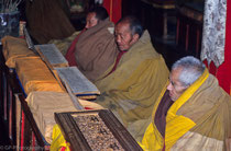 Old monks praying  in Tashilhuenpo Monastery, Shigatse Tibet 1993