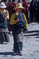 Woman with her praying wheel, Drepung Monastery, Tibet 1993