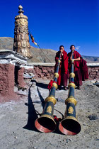 "Two monks playing the Tibetan horn ""Dungchen"", Sakya Monastery, Tibet 1993"