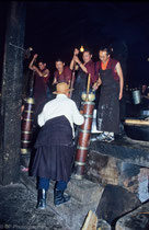 Tibetan monks churning butter tea in Drepung Monastery, Tibet 1993