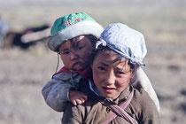 Young girl with her sister on her back, Sakya, Tibet 1993