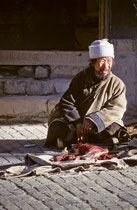 Man selling meat in the streets of Shigatse, Tibet 1993