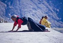 Woman prostrating, Drepung Monastery, Tibet 1993