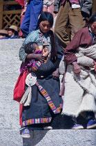 Woman breast feeding her baby, Drepung Monastery, Tibet 1993