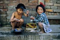Two young girls washing hair, Durbar square, Kathmandu, Nepal 1993