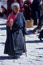 Old woman rolling the prayer wheel, Drepung Monastery, Tibet 1993
