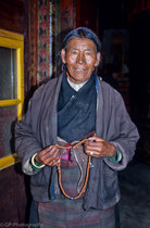 Old woman with prayer beads, Shigatse, Tibet 1993
