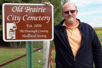Prairie City mayor John Oakman accepts a new sign donated by the McDonough County Historical Society for the Old Prairie City Cemetery.