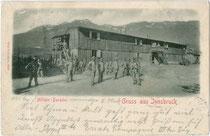 Militärbaracke wohl im Osten von Innsbruck. Lichtdruck 9 x 14 cm; Impressum: Otto Schuricht, Solbad Hall (heute: Hall in Tirol); postalisch befördert 1901.  Inv.-Nr. vu914ld00321