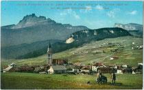 Cortina d'Ampezzo mit Croda da Lago und Monte Nuvolau in den Ampezzaner Dolomiten. Photochromdruck 9 x 14 cm; Impressum: Joh(ann). F(ilibert). Amonn, Bozen 1909.  Inv.-Nr. vu914pcd00266a
