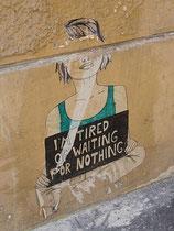 """Beschädigtes Paste-up mit unterlegtem Text """"I'am tired of waiting for nothing"""" in Innsbruck, Innere Stadt, Universitätsstraße 10 - inzwischen entfernt worden. Digitalphoto; © Johann G. Mairhofer 2012.  Inv.-Nr. DSC04397"""